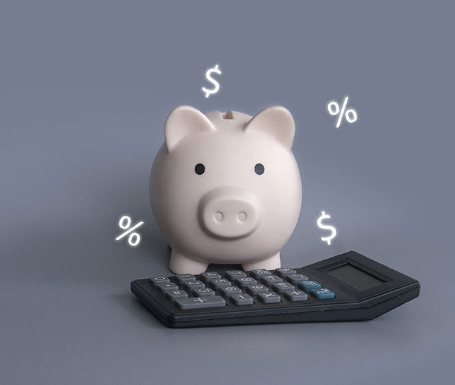 Piggy back with calculator, icons of money and percentage around it