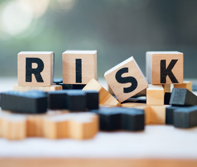 Wooden block with alphabet building the word RISK