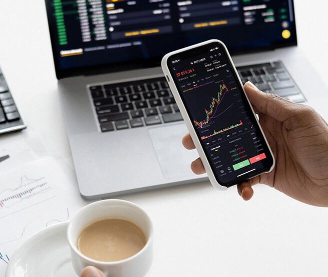 Man checking investments progress on phone